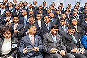 21 AUGUST 2014 - BANGKOK, THAILAND:       PORNPETCH WICHITCHOLCHAI (center, blue tie), President of the Thai National Legislative Assembly (NLA) after the NLA's group photo had been taken before their meeting to select a new Prime Minster. The NLA was hand selected by the Thai junta, formally called the National Council for Peace and Order (NCPO), and is supposed to guide Thailand back to civilian rule after a military coup overthrew the elected government in May. The NLA unanimously selected General Prayuth Chan-ocha, commander of the Thai Armed Forces and leader of the coup in May that deposed the elected civilian government, as Prime Minister. Prayuth is Thailand's 29th Prime Minister since the 1932 coup that created Thailand's constitutional monarchy.  PHOTO BY JACK KURTZ