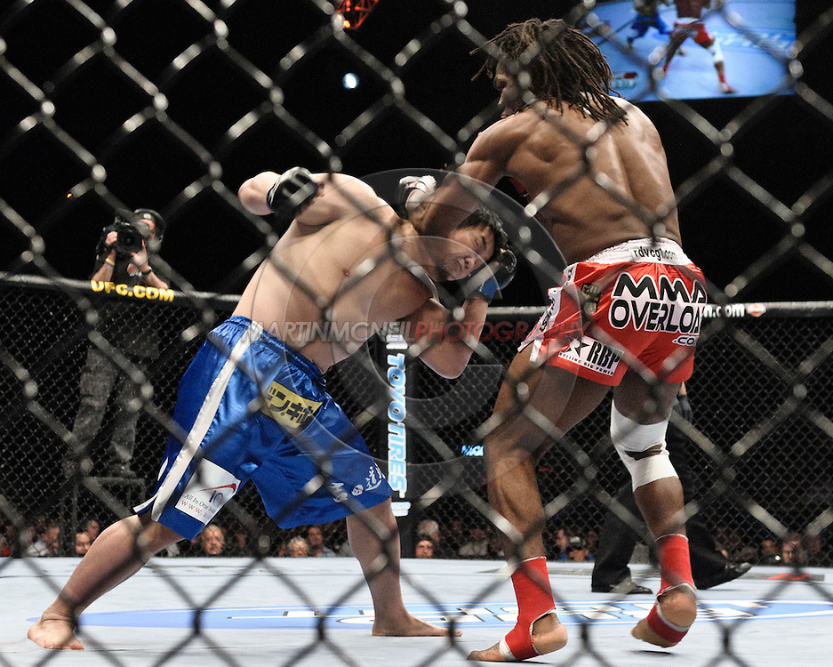 "LAS VEGAS, NEVADA, MAY 24, 2008: Kazuhiro Nakamura (left) is clipped by a short left hook from Thierry Rameau Sokoudjou during ""UFC 84: Ill Will"" inside the MGM Grand Garden Arena in Las Vegas"