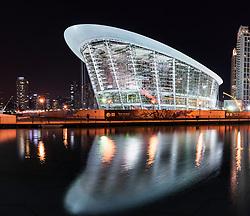 Night view of new Dubai Opera House under construction in Downtown Dubai United Arab Emirates