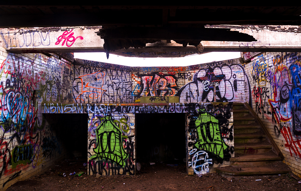 A picture of a 1940's seaside watch bunker now abandoned and covered in graffiti.<br />