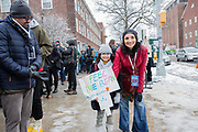 "Brooklyn, NY - 2 March 2019. A girl and her mother waint to get in to the first rally for Bernie Sanders'  2020 presidential primary at Brooklyn College. The girl carries a sign that reads ""I feel the Bern."""