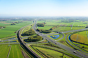 Nederland, Gelderland, Deil, 24-10-2013; knooppunt Deil, kruising A2 (vlnr, Utrecht - Den Bosch) en A15, richting Tiel. Betuweroute links en parallel aan A15.<br /> Deil junction, main motorway A15 Rotterdam Harbour - Germany crossing A2 to the South. <br /> luchtfoto (toeslag op standaard tarieven);<br /> aerial photo (additional fee required);<br /> copyright foto/photo Siebe Swart.