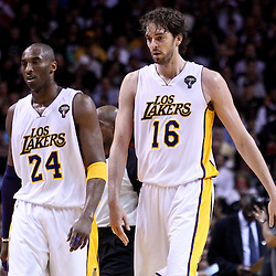 March 10, 2011; Miami, FL, USA; Los Angeles Lakers shooting guard Kobe Bryant (24) and power forward Pau Gasol (16) walk off the court during a second quarter timeout of a game against the Miami Heat at the American Airlines Arena.  Mandatory Credit: Derick E. Hingle