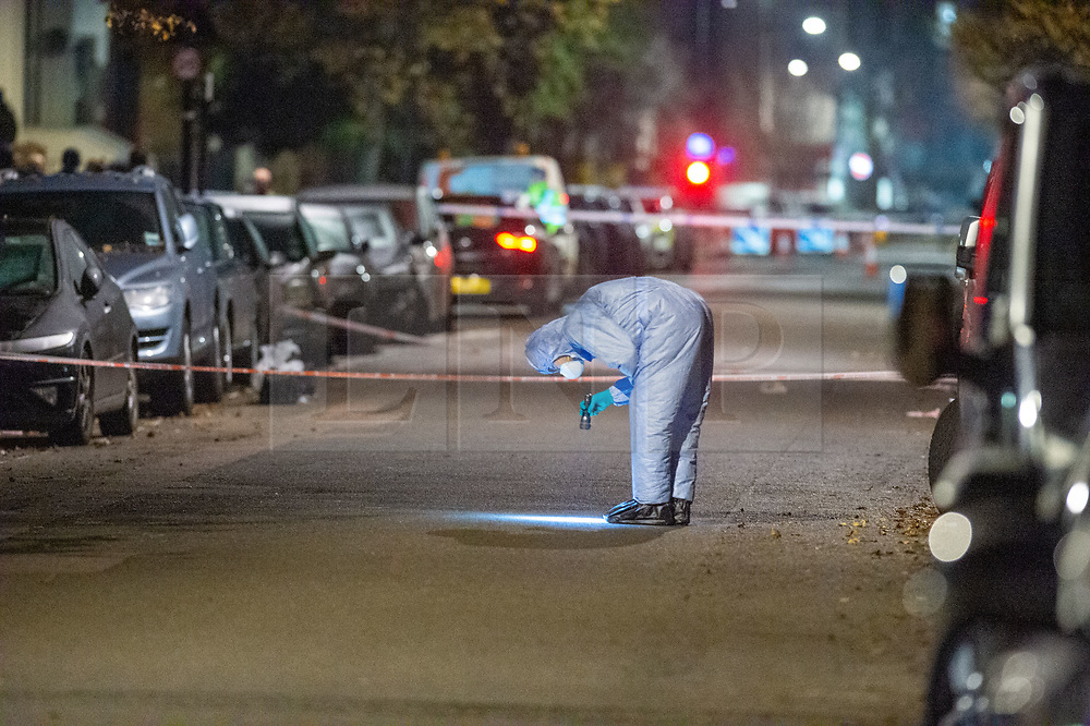 © Licensed to London News Pictures. 04/12/2019. London, UK. A forensic investigation gathers evidence. Police were called to reports of gunshots heard on Walterton Road, in Maida Hill, shortly before 8:30pm on Tuesday. A man in his late teens was found with a gunshot injury. Photo credit: Peter Manning/LNP