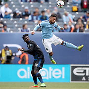 NEW YORK, NEW YORK - April 12: Ethan White #3 of New York City FC heads clear from Simon Dawkins #49 of San Jose Earthquakes during the New York City FC Vs San Jose Earthquakes regular season MLS game at Yankee Stadium on April 1, 2017 in New York City. (Photo by Tim Clayton/Corbis via Getty Images)
