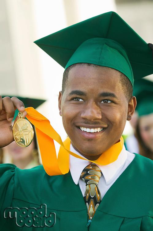 Graduate Holding Medal