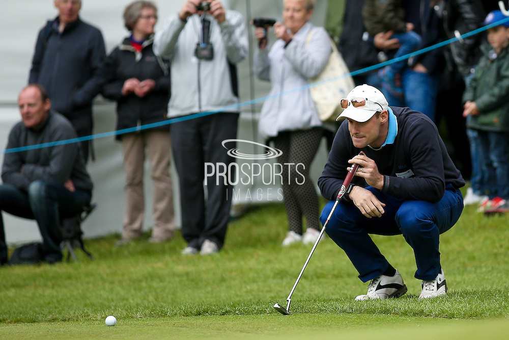 England cricket selector Andrew Strauss surveys his putt  during the BMW PGA Championship Celebrity Pro-Am Day at the Wentworth Club, Virginia Water, United Kingdom on 25 May 2016. Photo by Simon Davies.