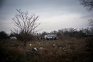 A group of independed volunteers offering some food to the migrants in a makeshift camp in the woods not far form the town of Subotica, about 10 Km from the Hungarian border. Hundreds of migrants are living in the woods waiting to cross the border. Subotica, Serbia. March 18th, 2017. Federico Scoppa/CAPTA