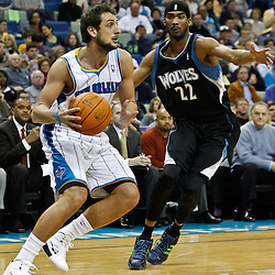 February 7, 2011; New Orleans, LA, USA; New Orleans Hornets shooting guard Marco Belinelli (8) is guarded by Minnesota Timberwolves shooting guard Corey Brewer (22) during the first quarter at the New Orleans Arena.   Mandatory Credit: Derick E. Hingle