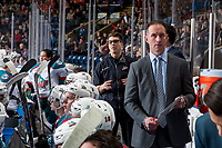 KELOWNA, CANADA - FEBRUARY 23:  Kelowna Rockets' equipment manger, Chaydyn Johson stands on the bench behind head coach Jason Smith against the Seattle Thunderbirds on February 23, 2018 at Prospera Place in Kelowna, British Columbia, Canada.  (Photo by Marissa Baecker/Shoot the Breeze)  *** Local Caption ***