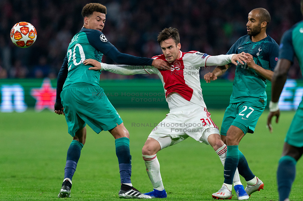 08-05-2019 NED: Semi Final Champions League AFC Ajax - Tottenham Hotspur, Amsterdam<br /> After a dramatic ending, Ajax has not been able to reach the final of the Champions League. In the final second Tottenham Hotspur scored 3-2 / Dele Alli #20 of Tottenham Hotspur, Nicolas Tagliafico #31 of Ajax, Lucas #27 of Tottenham Hotspur