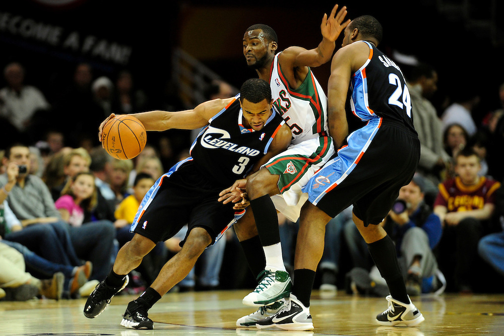 Jan. 21, 2011; Cleveland, OH, USA; Cleveland Cavaliers point guard Ramon Sessions (3) tries to drive around Milwaukee Bucks guard Keyon Dooling (55) as Cleveland Cavaliers power forward Samardo Samuels (24) sets a pic during the first quarter at Quicken Loans Arena. Mandatory Credit: Jason Miller-US PRESSWIRE