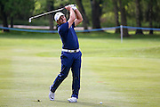 Italian golf professional Francesco Molinari  with his approach shot during the BMW PGA Championship at the Wentworth Club, Virginia Water, United Kingdom on 26 May 2016. Photo by Simon Davies.