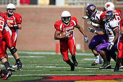 29 September 2007:  Geno Blow finds a path as wide as the interstate and starts his run. In action between the Northern Iowa Panthers and the Illinois State Redbirds, the Panthers chewed up the Redbirds by a score of 23 - 13. Game action commenced at Hancock Stadium on the campus of Illinois State University in Normal Illinois..