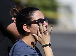 Oct 2, 2017 - Las Vegas, Nevada, U.S. - ARIA JAMES, of Ventura, Calif., is overcome with emotion while standing outside a barricade on the Las Vegas Strip near the Route 91 Harvest concert venue. A mass shooting occurred late Sunday evening at the music festival. (Credit Image: © Ronda Churchill via ZUMA Wire)