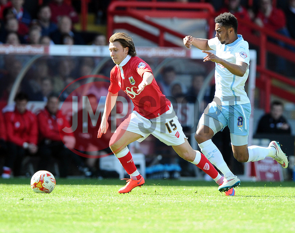 Bristol City's Luke Freeman battles for the ball with Coventry City's Grant Ward  - Photo mandatory by-line: Joe Meredith/JMP - Mobile: 07966 386802 - 18/04/2015 - SPORT - Football - Bristol - Ashton Gate - Bristol City v Coventry City - Sky Bet League One