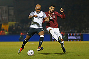Andre Wisdom and Vadaine Oliver compete for the ball during the The FA Cup match between Northampton Town and Derby County at the PTS Academy Stadium, Northampton, England on 24 January 2020.