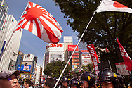 May 26, 2019, Tokyo Japan: As a group of approximately 500 Japanese anti-emperor activists protested against President Trump's meeting with Emperor Naruhito, they were harassed and heckled by a group of pro-emperor & pro Trump supporters. These right wingers and their fellow compatriots are notorious for disrupting rallies or demonstrations that cast Japan's Imperial system in a negative way. Due to this harassment, a high number of riot police are always on hand to keep these two group separated. This took place in the vicinity of Shinjuku Station with the police far outnumbering the protestors. Trump who is currently in Tokyo on an official four day state visit will attend a banquet on Monday 5/27 hosted by the Emperor Naruhito. He will be the first world leader to meet with the new emperor who ascended the Chrysanthemum Throne on May 1. Photo by Torin Boyd.