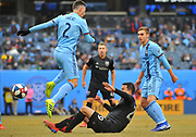 New York City Football Club defensemen Ben Sweat (2)  kicks the ball against Leonardo Jara (29) during first half of an MLS soccer game at Yankee Stadium in New York, NY, Sunday, March 10, 2019. (Bennett Cohen/image of Sport)