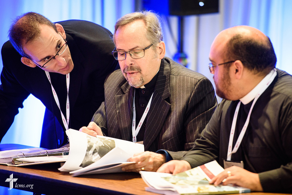 "The Rev. Dan Gilbert, president of the Northern Illinois District (center), confers with fellow Floor Committee 4 ""Life Together"" members on Thursday, July 14, 2016, at the 66th Regular Convention of The Lutheran Church–Missouri Synod, in Milwaukee. LCMS/Michael Schuermann"