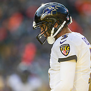 Baltimore Ravens quarterback Joe Flacco walks back to the huddle between plays during an NFL football game against the Green Bay Packers Sunday, Nov. 19, 2017, in Green Bay, Wis. (AP Photo/Matt Ludtke)