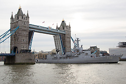 "© Licensed to London News Pictures. 29/11/2013. London, UK. The Belgian Frigate Louise Marie arrives in London on 29 November 2013 bringing ""sacred soil"" from cemeteries of First World War Battlefields in Flanders and moors next to HMS Belfast on the River Thames. Tower Bridge was raised fully in complement, for the first time since the Diamond Jubilee Pageant in 2012. Photo credit : Vickie Flores/LNP"