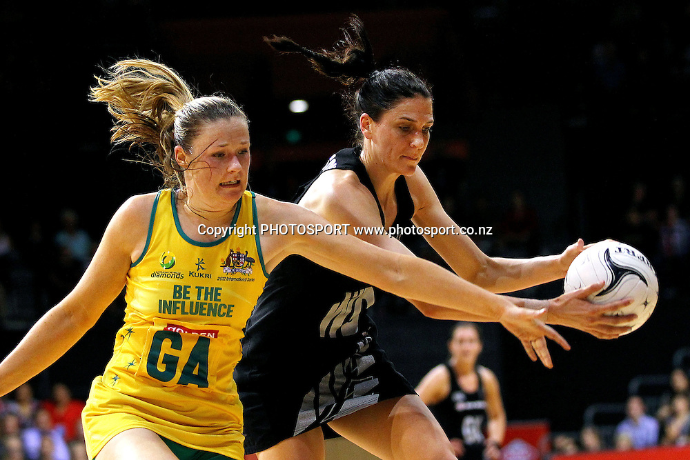 Silver Fern's Anna Harrison gets the ball ahead of Australia's Susan Pratley. New World Quad Series, New Zealand Silver Ferns v Australian Diamonds at Claudelands Arena, Hamilton, New Zealand. Thursday 1st November 2012. Photo: Anthony Au-Yeung / photosport.co.nz