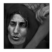 Faces of Mosul<br /> <br /> A collection of images from 4 time Pulitzer prize winning photographer Carol Guzy, gives us a glimpse into the faces of those affected by the fierce conflict with ISIS in Mosul. Wounded and weak, most who survived now face an uncertain future in the limbo of IDP camps. Shattered lives, lost loved ones and escape from the rubble of collapsed homes and the evil of ISIS doctrine, leaves scars of emotional trauma even more difficult to heal. The war in Mosul is over, but the humanitarian crisis continues.<br /> <br /> Mosul, Iraq - Civilians, many injured and weak, flee as battle with ISIS continues in West Mosul amid ruins of the Old City. <br />  &copy;Carol Guzy/zReportage.com/Exclusivepix Media
