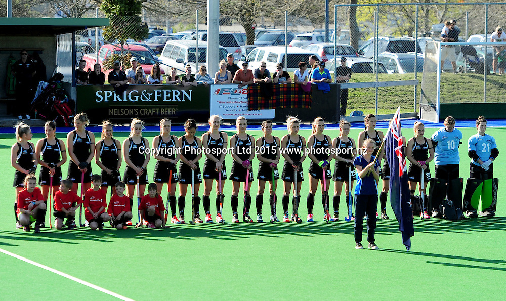 Black Sticks team stand for the National Anthem during their 2015 South Island Tour game between the New Zealand Black Sticks Women v Argentina. Saxton Turf, Nelson, New Zealand. Tuesday 6 October 2015. Copyright Photo: Chris Symes / www.photosport.nz