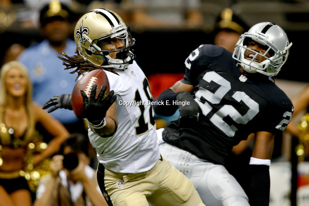 Aug 16, 2013; New Orleans, LA, USA; Oakland Raiders defensive back Taiwan Jones (22) is called for pass interference as New Orleans Saints wide receiver Saalim Hakim (18) is unable to hold on to a catch during the second half of a preseason game at the Mercedes-Benz Superdome. The Saints defeated the Raiders 28-20. Mandatory Credit: Derick E. Hingle-USA TODAY Sports