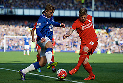 LIVERPOOL, ENGLAND - Sunday, October 4, 2015: Liverpool's Alberto Moreno in action against Everton's Gerard Deulofeu during the Premier League match at Goodison Park, the 225th Merseyside Derby. (Pic by Lexie Lin/Propaganda)