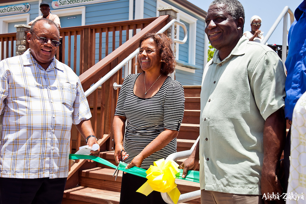 Ribbon cutting ceremony.  (L-R) Honorable St. Claire N. Williams, Commissioner; Ms. Donna Berry, Coki Point Beach Facility Vendor, Sun Seekers Beach Rentals; and Lt. Gov. Gregory R. Francis.  Department of Housing, Parks & Recreation, Coki Point Beach Facility Rededication Ceremony.  2 August 2012.  © Aisha-Zakiya Boyd