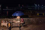 A food vendor waits for customers along the boat docks November 1, 2017 in Janitzio Island, Michoacan, Mexico.