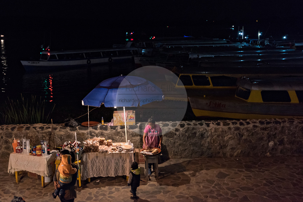 A food vendor waits for customers along the boat docks November 1, 2017 in Janitzio Island, Michoacan, Mexico.