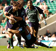 20040904 London Irish v Harlequins. Zurich Premiership..Exiles wing Scott Staniforth, find his run halted..Photo  Peter Spurrier.email images@intersport-images Mob +447973819551.