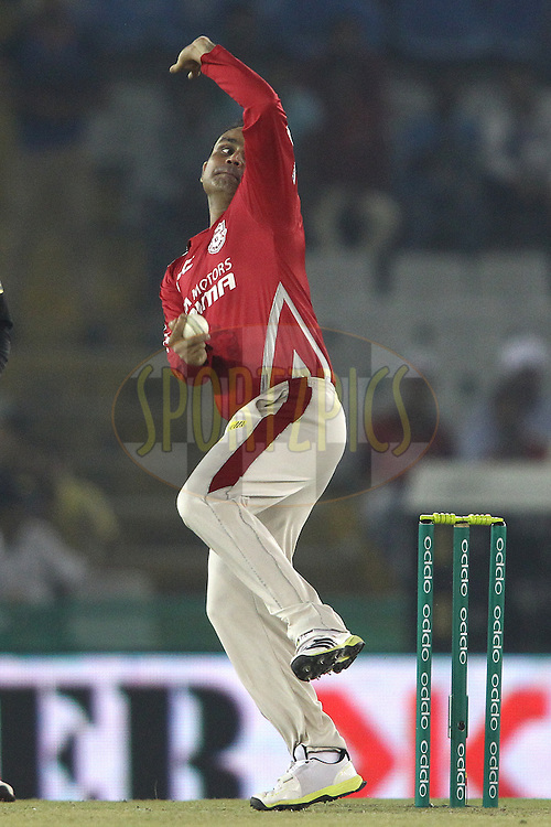 Virender Sehwag of the Kings XI Punjab sends down a delivery during match 2 of the Oppo Champions League Twenty20 between the Kings XI Punjab and the Hobart Hurricanes held at the Punjab Cricket Association Stadium, Mohali, India on the 18th September 2014<br /> <br /> Photo by:  Shaun Roy / Sportzpics/ CLT20<br /> <br /> <br /> Image use is subject to the terms and conditions as laid out by the BCCI/ CLT20.  The terms and conditions can be downloaded here:<br /> <br /> http://sportzpics.photoshelter.com/gallery/CLT20-Image-Terms-and-Conditions-2014/G0000IfNJn535VPU/C0000QhhKadWcjYs