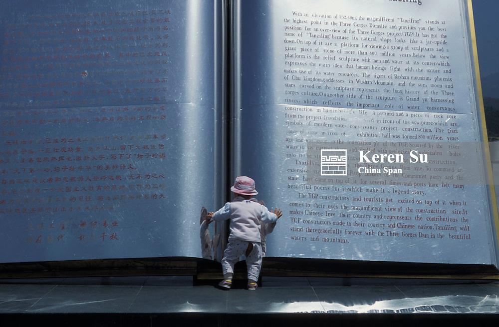 A baby with sculpture of a big book, in memory of Three Gorges Dam, Yichang, Hubei Province, China