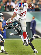 Giants running back Brandon Jacobs tries to hurdles Asante Samuel during the second quarter as the Philadelphia Eagles take on the New York Giants at Lincoln Financial Field in Philadelphia, PA on November 9, 2008. Jacobs fumbled the ball on the play leading to an Eagles touchdown.