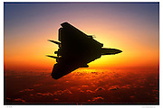 F-14A banking away at sunset