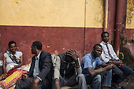 Migrants rest next to the Tiburtina train station in Rome on Sunday. Hundreds of migrants, many from Ethiopia, Somalia and Eritrea, arrived in recent months on boats from Libya. They were brought to Italy after being rescued at sea.