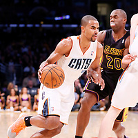 31 January 2014: Charlotte Bobcats point guard Ramon Sessions (7) drives past Los Angeles Lakers shooting guard Jodie Meeks (20) during the Charlotte Bobcats 110-100 victory over the Los Angeles Lakers at the Staples Center, Los Angeles, California, USA.