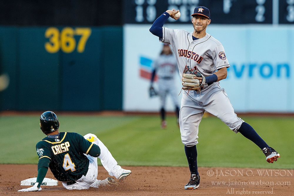 OAKLAND, CA - JULY 19:  Carlos Correa #1 of the Houston Astros completes a double play around Coco Crisp #4 of the Oakland Athletics during the first inning at the Oakland Coliseum on July 19, 2016 in Oakland, California. (Photo by Jason O. Watson/Getty Images) *** Local Caption *** Carlos Correa; Coco Crisp