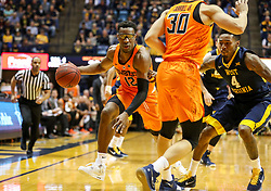 Feb 10, 2018; Morgantown, WV, USA; Oklahoma State Cowboys forward Cameron McGriff (12) dribbles in traffic during the first half against the West Virginia Mountaineers at WVU Coliseum. Mandatory Credit: Ben Queen-USA TODAY Sports