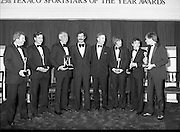 "Texaco Sportstars Of The Year Awards.1983..14.04.1983..04.14.1983..14th April 1983...Image of The Tanaiste Dick Spring and MrTony Hill,M.D.Texaco Ireland(centre) after the presentation of the awards to: (L-R),.Noel Skehan,Hurling..Martin Furlong,Football..Ronnie Delaney,Athletics..Ronnie was inducted into ""The Hall Of Fame""..Ollie Campbell,Rugby..Barry McGuigan,Boxing..Alex Higgins,Snooker..The Awards ceremony took place in The Burlington Hotel,Dublin."