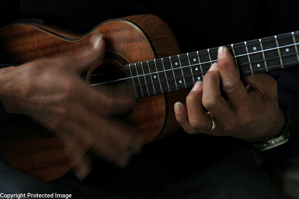 Ex-cowboy, Kaiwi Kihoi, plays his ukelele at his home in Waimea, Hi.  Kihoi is well-known for his musical talent in the paniolo community and sometime plays at local weddings and events.  The Paniolo music is a mixture of Hawaiian music and Mexican music brought over by the vaqueros almost two centuries ago.