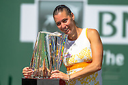 Indian Wells, CA - Flavia Pennetta of Italy celebrates victory with her team and gets watered during the BNP Paribas Open.