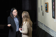 Rebecca Choi, left, an Assistant Professor of Restaurant and Hotel Tourism at Ohio University, speaks with her student, Rebecca Biss during a lecture on event planning at Arts West in Athens, Ohio on February 21, 2017.
