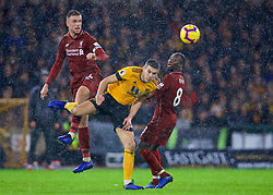 WOLVERHAMPTON, ENGLAND - Friday, December 21, 2018: Liverpool's captain Jordan Henderson and Wolverhampton Wanderers' captain Conor Coady during the FA Premier League match between Wolverhampton Wanderers FC and Liverpool FC at Molineux Stadium. (Pic by David Rawcliffe/Propaganda)