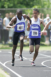 Hamilton, Ontario ---06/06/08--- Oluwasegun Makinde of Colonel By in Gloucester competes in the 4X100 meter relay at the 2008 OFSAA Track and Field meet in Hamilton, Ontario..SEAN BURGES