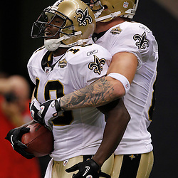 September 9, 2010; New Orleans, LA, USA;  New Orleans Saints wide receiver Devery Henderson (19) celebrates with New Orleans Saints tight end Jeremy Shockey (88) after scoring a touchdown during the first quarter against the Minnesota Vikings during the NFL Kickoff season opener at the Louisiana Superdome. Mandatory Credit: Derick E. Hingle